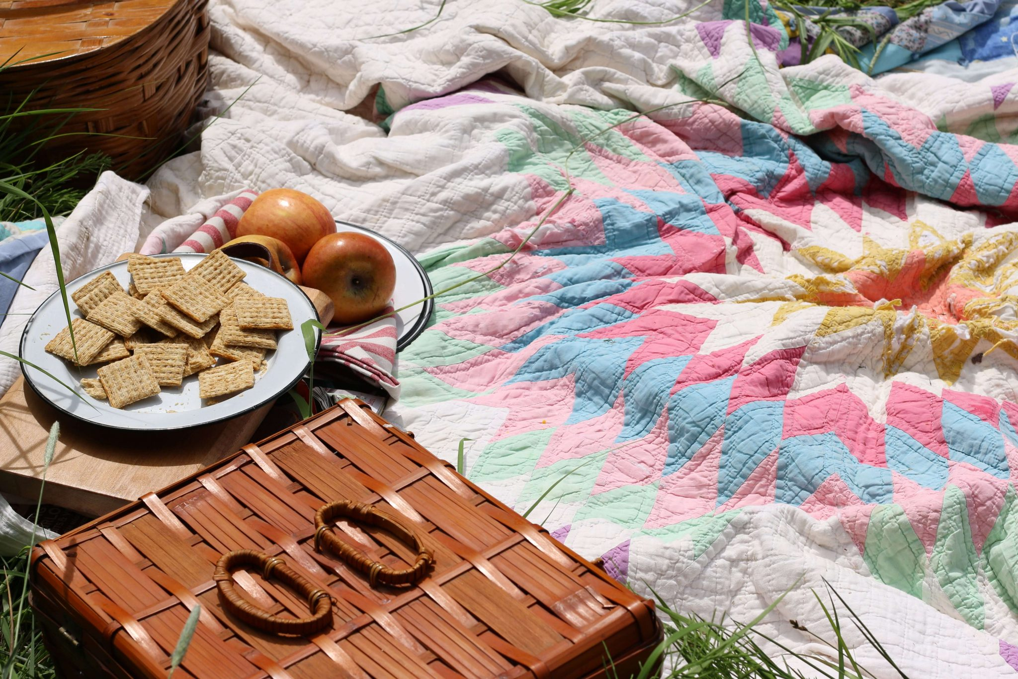 A Picnic with old quilts, good food and the beautiful outdoors!