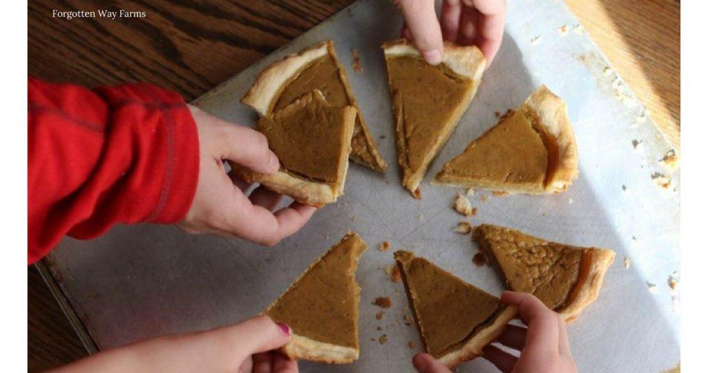 Homemade pumpkin pie slices on a baking sheet