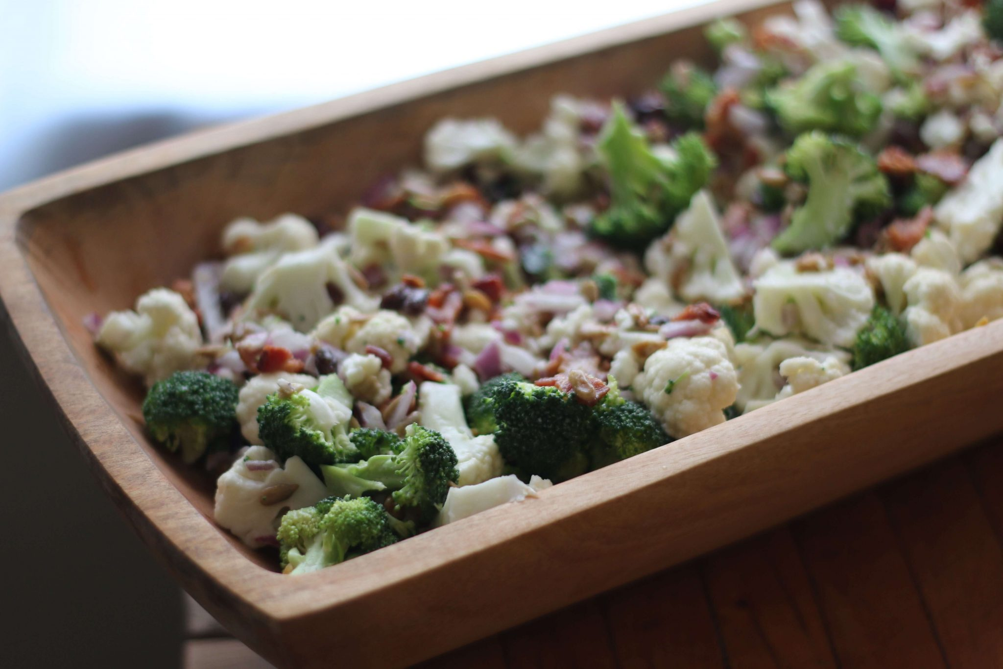 Broccoli, Cauliflower, and Bacon Salad, what a delicious easy recipe! This looks so pretty, not to mention festive. Especially for Thanksgiving!
