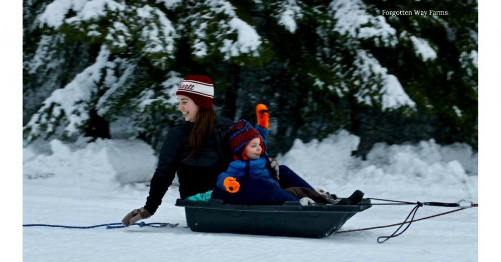 two kids sledding
