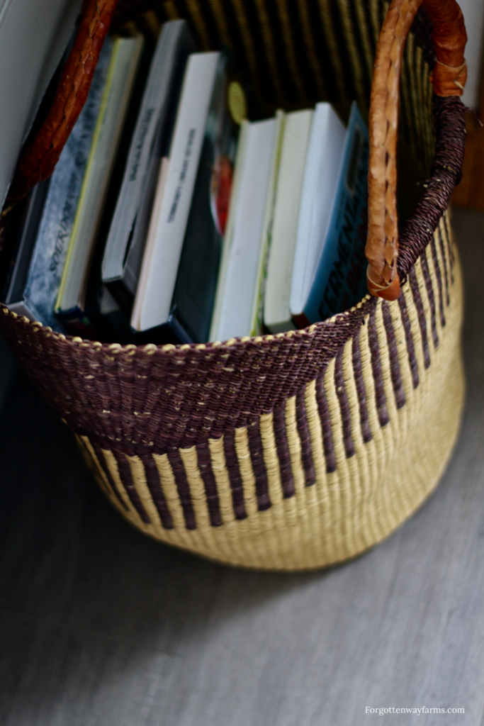 A woven basket holding books.