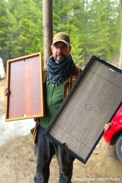Man holding two Easy Nickel Hockey DIY Game Boards.