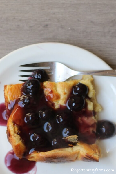A plate of easy breakfast food, Dutch Baby with blueberry syrup.