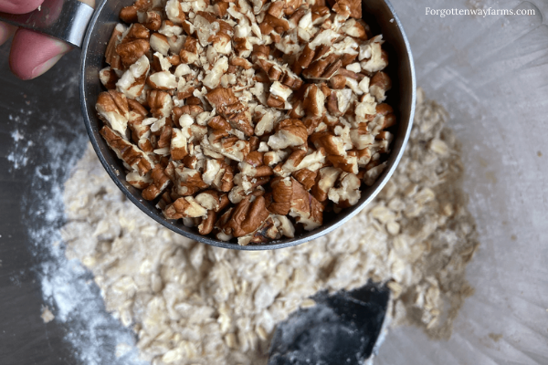 Adding pecans to crumble mixture.
